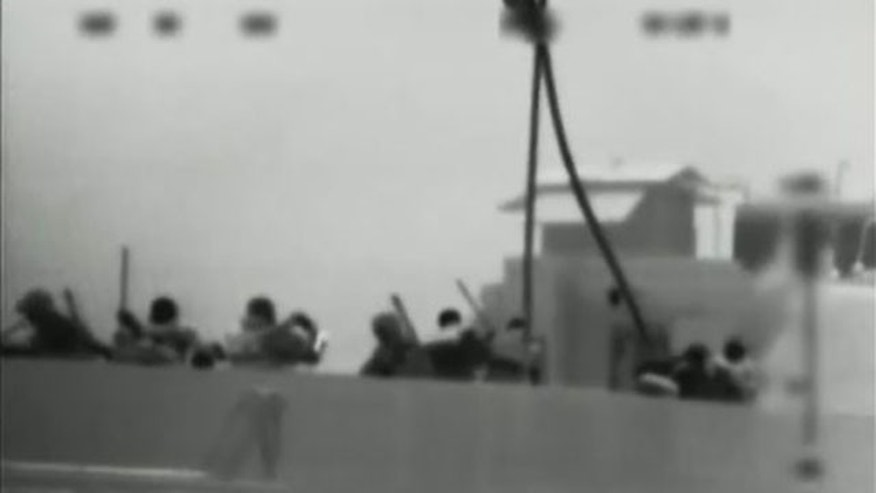 May 31: This image made from video provided by the Israeli Defence Force shows what the IDF says is one of several commandos being dropped onto the Mavi Marmara ship by helicopter in the Mediterranean Sea. Israeli commandos rappelled down to an aid flotilla sailing to thwart a Gaza blockade on Monday, clashing with pro-Palestinian activists on the lead ship in a raid that left at least nine passengers dead.