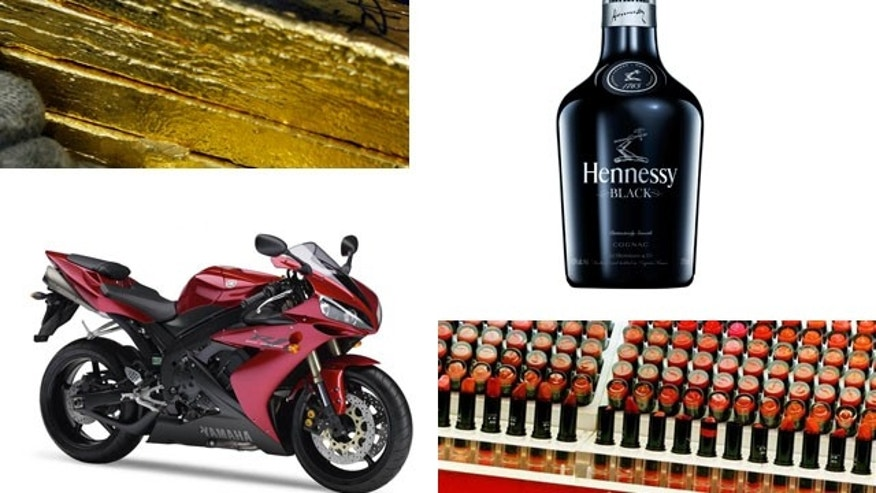 Some luxury goods sanctioned include gold (Reuters), alcohol (Reuters), motorcycles (Yamaha), and cosmetics (AP).