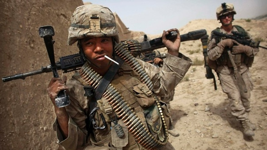 July 23: A U.S. Marine has a cigarette following a gun battle attempting to clear the area of insurgents in Helmand Province in southern Afghanistan.