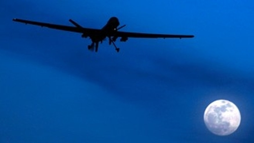 File: A predator drone flies over the moon above Kandahar Air Field in southern Afghanistan. U.S. missiles hit a suspected militant hide-out killing 16 insurgents in a troubled Pakistani tribal region along the Afghan border before dawn Saturday, July 24,  intelligence officials said.