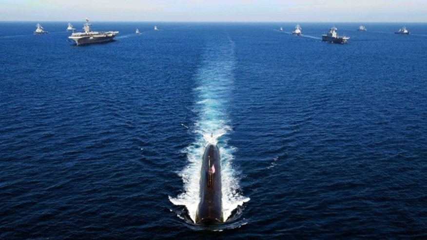 July 26: U.S. Navy and South Korea ships transit the East Sea in a 13-ship formation led by the Los Angeles-class attack submarine USS Tuscon.