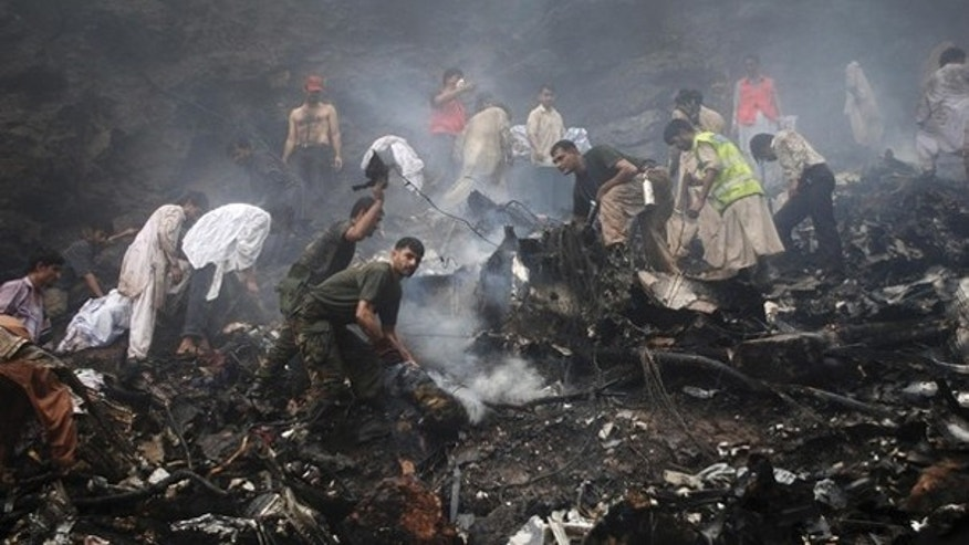 July 28: Soldiers, rescue workers and residents search through the wreckage of an Airblue passenger plane which crashed in Islamabad's Margalla Hills July 28. The Pakistani passenger plane, an Airbus 321 belonging to Airblue, crashed in heavy rain near Islamabad, killing all 152 people on board in the worst aviation accident in Pakistan's history. (Reuters)