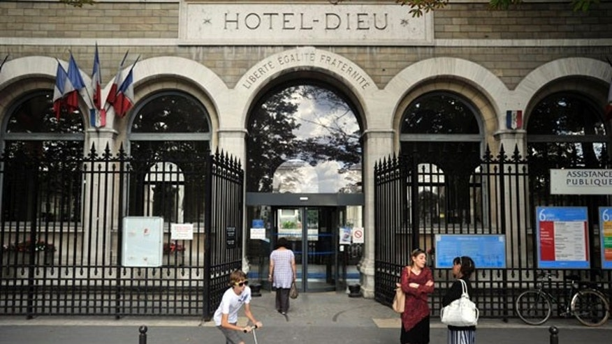 July 30: Exterior view of the Hotel Dieu hospital in Paris, where two employees of the U.S. embassy were undergoing medical tests after handling a suspicious letter.