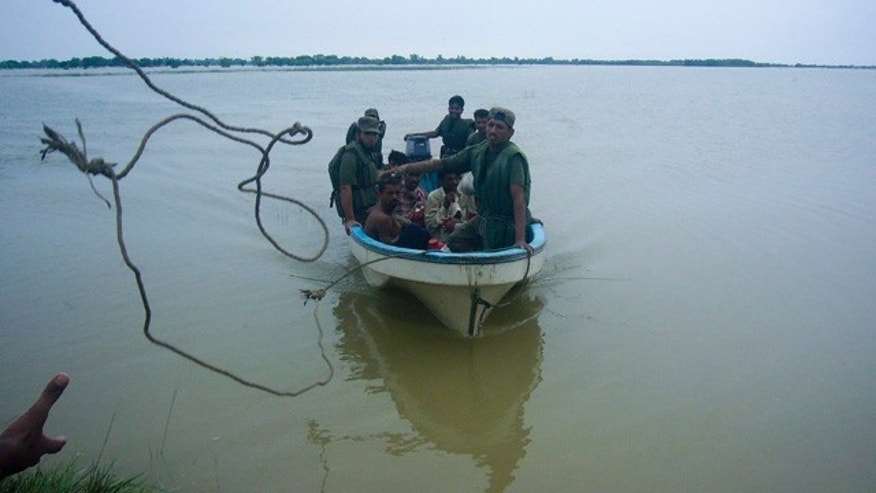 Aug. 3: Pakistan army soldiers rescue stranded villagers in Dera Ghazi Khan.
