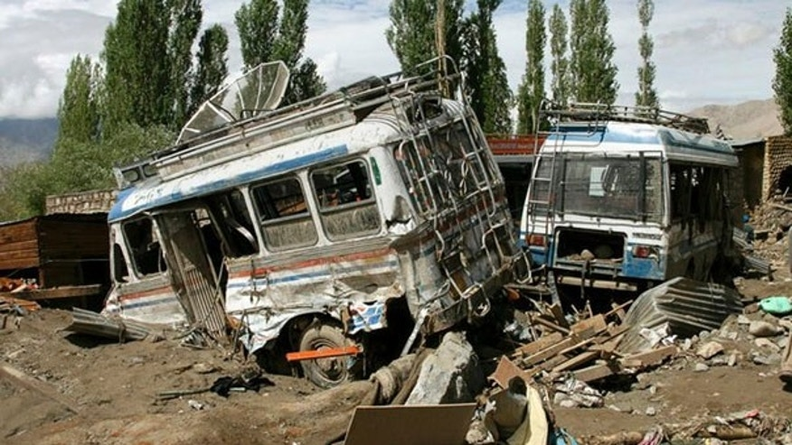 Aug. 6: Wrecked buses sit amid the rubble after flash floods killed more than 100 in Indian-controlled Kashmir's normally arid, mountainous region of Ladakh.