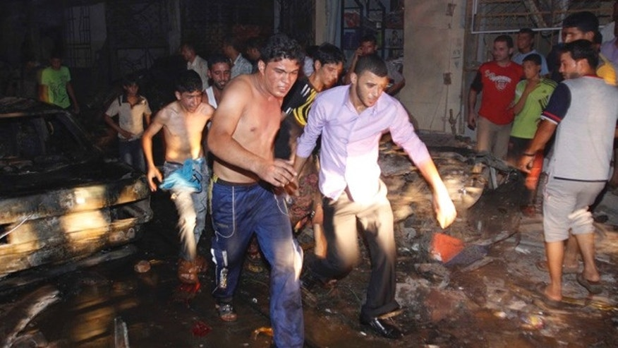 Aug. 7: Iraqi men evacuate a victim from the scene of an explosion in Basra, Iraq's second-largest city, 340 miles southeast of Baghdad, Iraq.