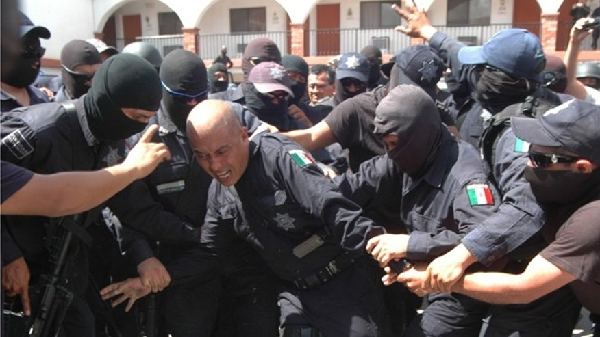 "Aug. 7: Federal police officers beat fellow police inspector Salomón Alarcón Olvera, aka ""El Chaman"" after accusing him of being linked to drug cartels and having participated in kidnappings, executions and extortions in Ciudad Juarez, northern Mexico."