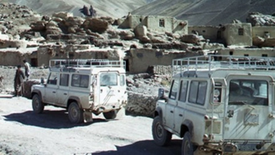 In this undated photo released by David L. Evans, two Land Rovers with International Assistance Mission personnel aboard, navigate down a road in an unnamed region of Afghanistan. Members of a medical team were shot and killed by militants as they were returning from providing eye treatment and other health care in remote villages in northern Afghanistan, a spokesman for the team said Saturday, Aug. 7, 2010.  Dirk Frans, director of the International Assistance Mission, said six Americans, one German, one Briton and two Afghans also were part of the medical team that made the three-week trip to Nuristan province. They drove to the province, left their vehicles and hiked for hours with pack horses over mountainous terrain to reach the Parun valley in the province's northwest.  (AP Photo/Provided by David L. Evans) NO SALES