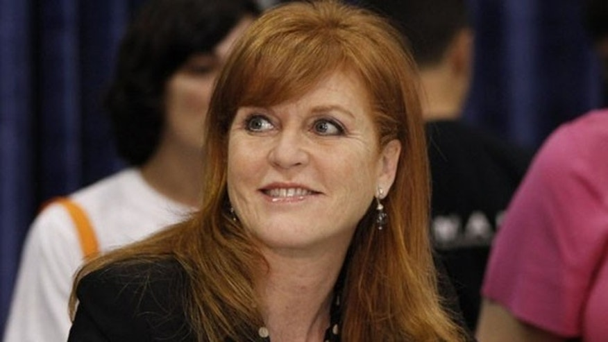 "May 26: Sarah Ferguson, Britain's Duchess of York, signs copies of her book ""Helping Hand Books: Emily's First Day at School"" at the BookExpo America in New York."