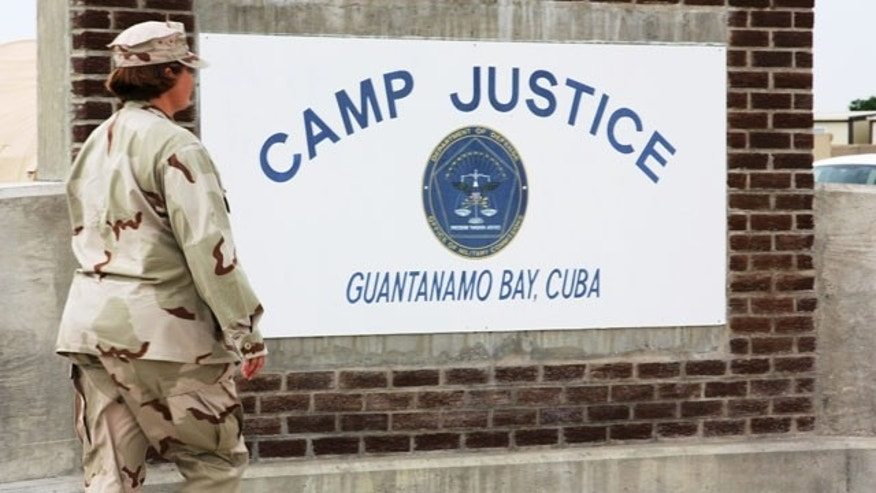 Aug. 8: A U.S. Navy personnel is seen walking past a monument at Camp Justice, site of the military commission courthouse where Canadian citizen Omar Khadr is set to be tried for war crimes at Guantanamo Bay, Cuba.