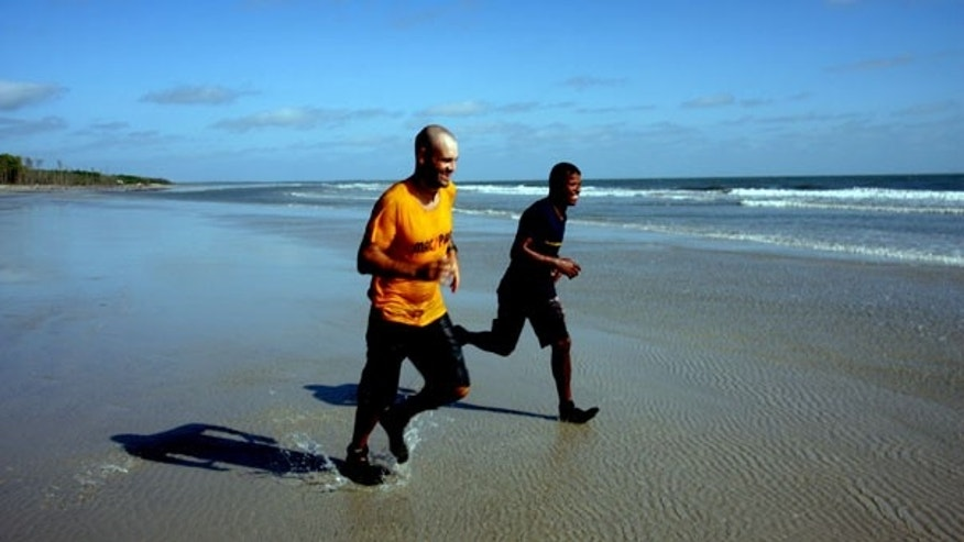 Aug. 9: Ed Stafford of England, accompanied by Gadiel Sanchez Rivera of Peru, arrives to Brazil's Crispim beach on the Atlantic Ocean after walking the entire length of the Amazon river.