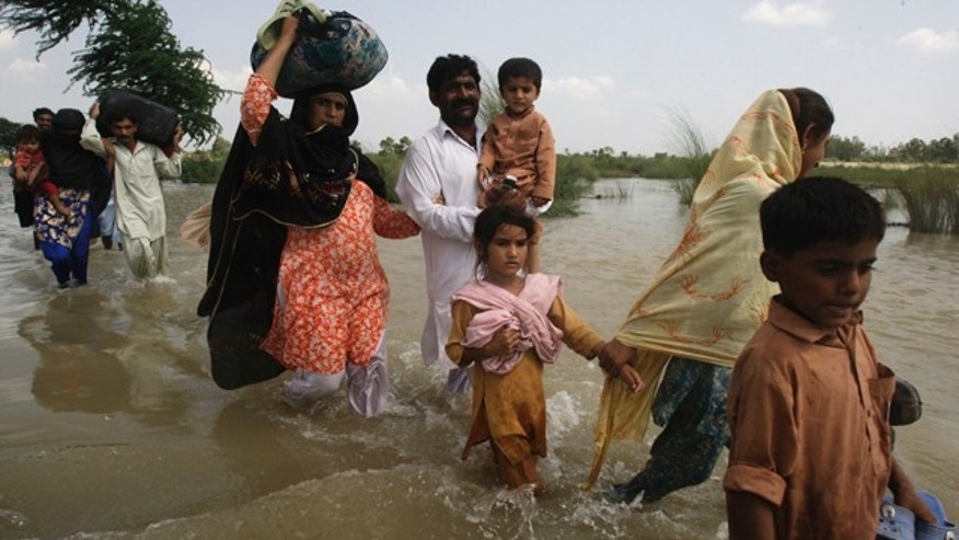 Aug. 12: Flood affected people wade through water to reach safer areas in Multan, Pakistan.