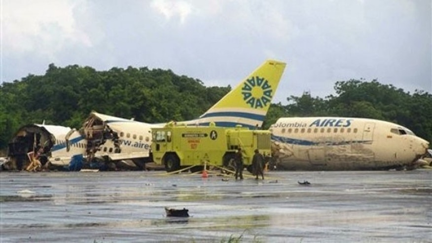 Aug. 16: A plane that crashed lays in pieces along the runaway at the airport on San Andres island in Colombia. The Boeing 737 operated by the airline Aires crashed on landing after departing from Bogota around midnight local time with 131 passengers (AP).