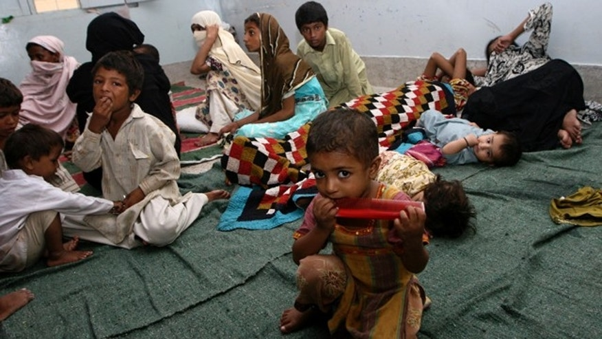 Aug. 17: Residents displaced by heavy floods take shelter in a camp in Karachi, Pakistan.