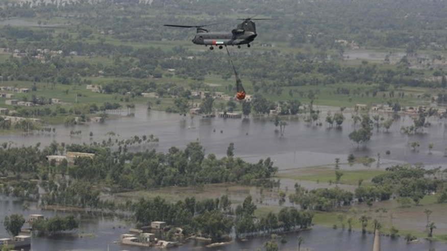 Aug. 18: A United Arab Emirates Chinook carries food supply over Punjab province. Pakistan senior meteorologist Arif Mahmood said floodwaters won't fully recede until the end of the month, and existing river torrents were still heading toward major cities in the country's south.