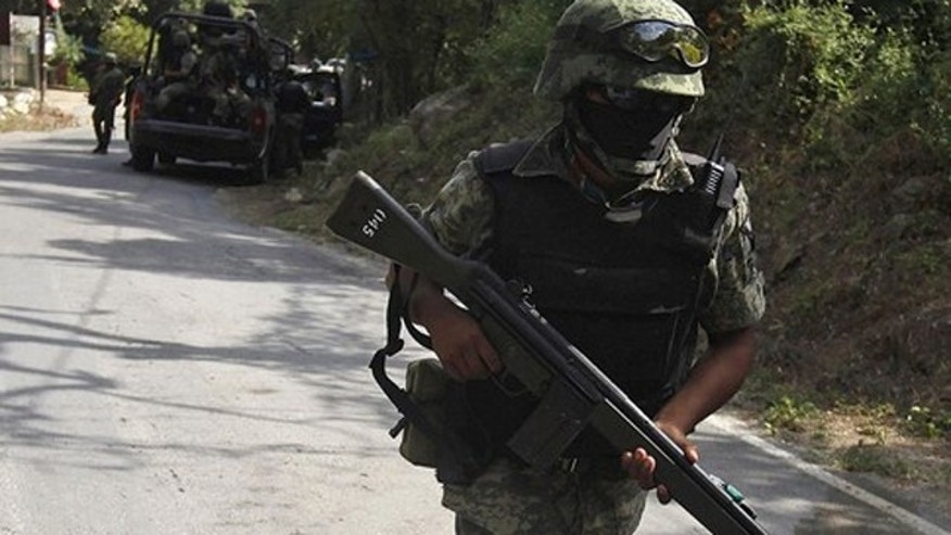 Aug. 18: Mexican soldiers arrive to secure a crime scene where where the body of Edelmiro Cavazos, mayor of the tourist town of Santiago, was found on a local road in the municipality of Santiago, some 18.6 miles away from Monterrey.
