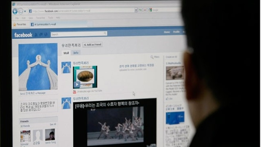 "A South Korean journalist looks at a computer screen showing an alleged North Korean Facebook account which carries content condemning ""warmongers"" South Korea and the U.S. in Seoul, South Korea, Friday, Aug. 20, 2010."