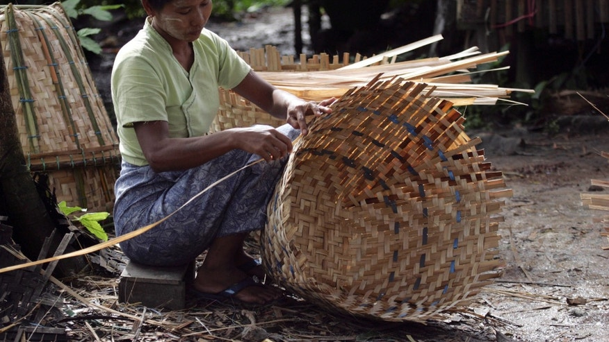 Aug. 15: A woman makes a bamboo basket in Twantay, about 19 miles south of Rangoon, Burma.