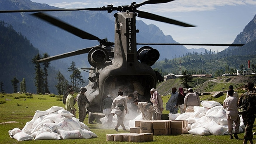 Aug. 20: Workers unload flood relief supplies from a U.S. helicopter in Kalam, in Pakistan's Swat Valley.