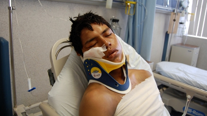 Aug. 24, 2010: Luis Fredy Lala Pomavilla of Ecuador rests at a hospital in eastern Mexico after surviving a drug cartel massacre that killed 72 Central and South American migrants.