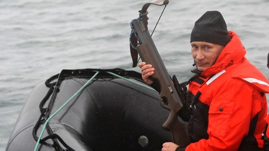 Aug. 25: Russian Prime Minister Vladimir Putin holds a crossbow as he sits on a rubber boat at the Olga Harbor of Kamchatka Peninsula during a scientific expedition.