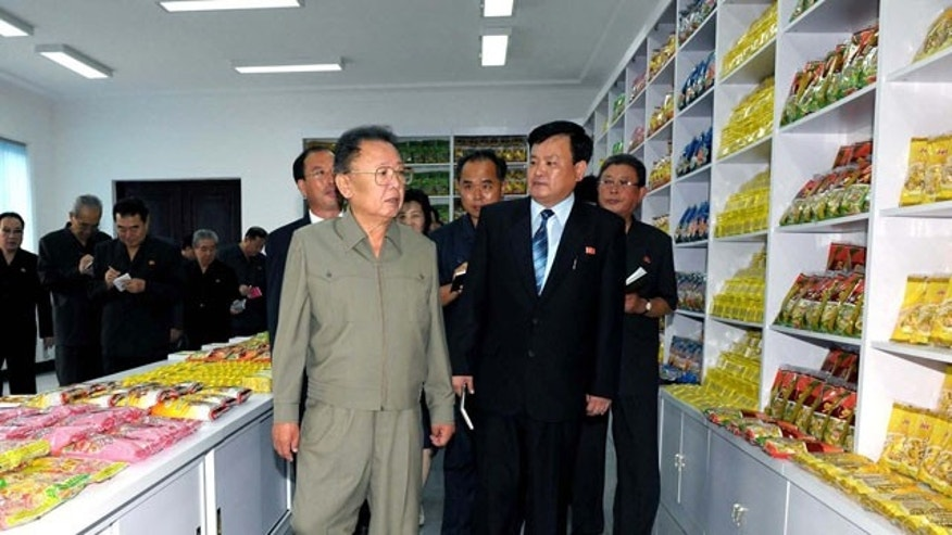 In this undated photo released by Korean Central News Agency via Korea News Service in Tokyo on Thursday, Aug. 26, 2010, North Korean leader Kim Jong Il, foreground, visits Pyongyang Cornstarch Factory in Pyongyang, North Korea. (AP)