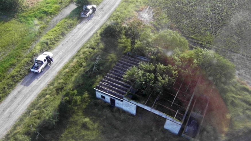 Aug. 24: This image released by Mexico's Navy shows the alleged site where the bodies of 72 South American migrants were found.