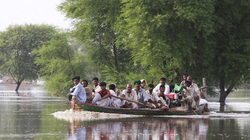 Aug. 28: Pakistanis living on patches of land surrounded by floodwaters are ferried on a boat in what used to be farm lands. Floodwaters made another break Saturday in the levees protecting a southern Pakistani city, as thousands of residents fled for high ground and left the city nearly empty.