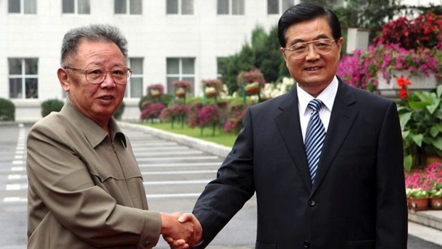 August 27: In this photo released by China's official Xinhua news agency, Chinese President Hu Jintao, meets with North Korean leader Kim Jong Il in Changchun, in northeast China's Jilin province. China on Monday confirmed North Korean leader Kim Jong  Il's visit. (AP)