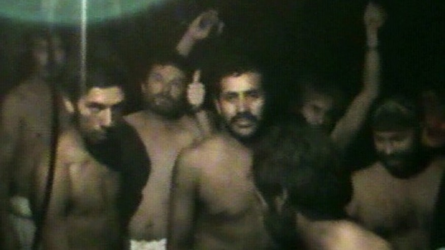 Aug. 29: This TV grab taken from a video released by Chile's government shows some of 33 trapped miners the San Jose mine in Copiapo.