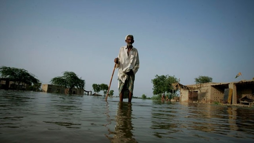 Sept. 3: An elderly villager wades through floodwaters in Khairpur near Dadu, Pakistan in Sindh province, Pakistan. The floods, spawned by heavy rains weeks ago in Khyber Pakhtunkhwa and elsewhere in the mountains of northern Pakistan, have killed more than 1,600 people and affected about 20 million people. (AP)