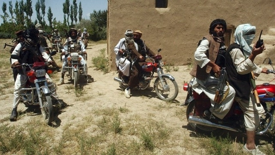 Taliban fighters ride on motorbikes in an undisclosed location in Afghanistan, July 14, 2009. (Reuters)