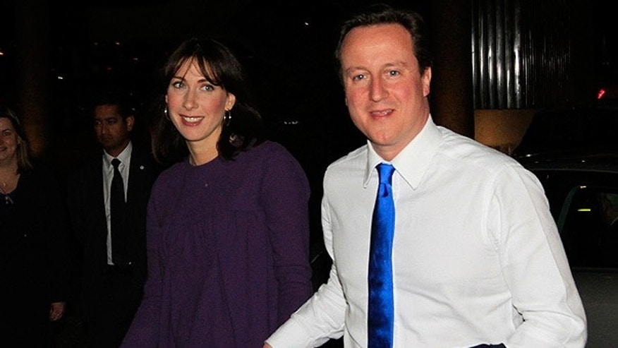 May 7: Conservative party leader David Cameron and his wife Samantha arrive at party headquarters in central London.