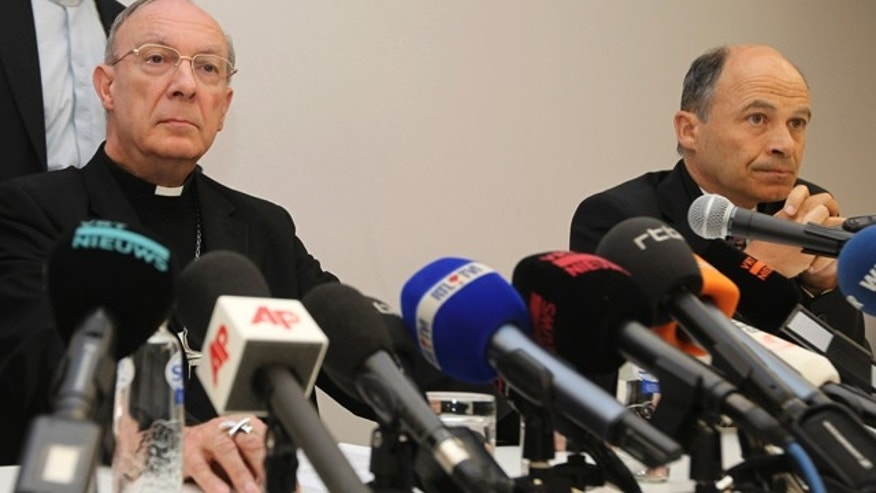 April 23, 2010: Belgium's Archbishop Andre-Joseph Leonard, left, and commission chairman Peter Adriaenssens address the media in Brussels about the sexual abuse by a Bishop. (AP Photo)