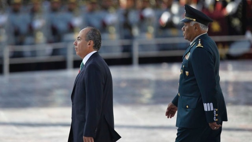 "September 13: Mexico's President Felipe Calderon, walks along Mexico's Defense Secretary Guillermo Galvan during the anniversary of the battle of the ""Ninos Heroes"", or Heroic Childre in Mexico City.  The ""Ninos Heroes"", or Heroic Children were a group of young cadets who died defending the military academy in Mexico City during the Mexican-American war in 1847. (AP)"