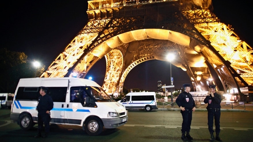 Sept. 14, 2010: Police officers stand in front of Paris' Eiffel Tower after an anonymous caller phoned in a bomb threat.