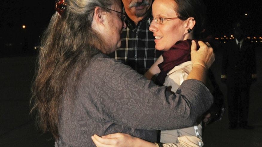 Sept. 2010: Sarah Shourd embraces her mother Nora Shourd upon arrival at the royal airport in Muscat, Oman.
