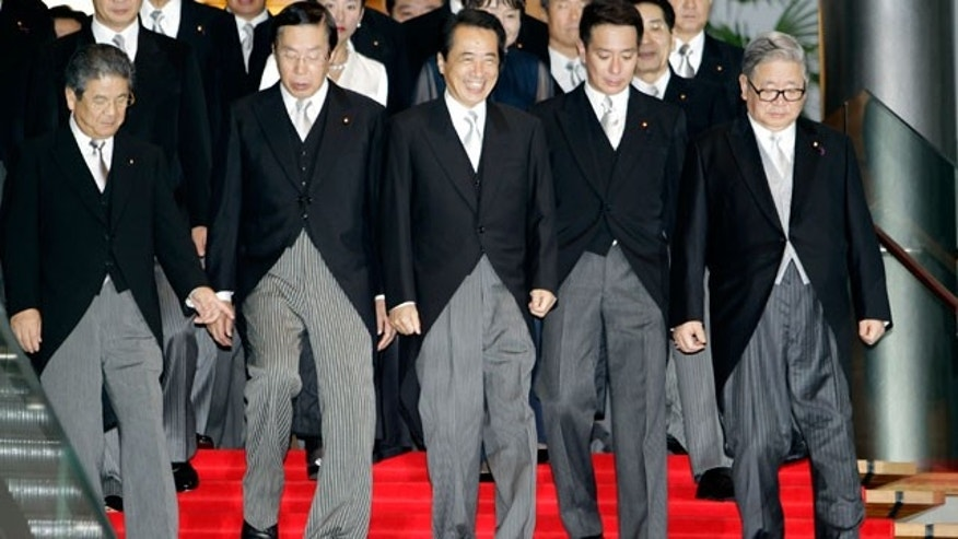 Japanese Prime Minister Naoto Kan, third from right, leads his new cabinet members to a photo session at the prime minister's official residence in Tokyo Friday, Sept. 17, 2010. Ministers from left in front row are Defense Minister Toshimi Kitazawa, Agriculture Minister Michihiko Kano, Kan, Foreign Minister Seiji Maehara, and State Minister in charge of financial and postal issue Shozaburo Jimi.