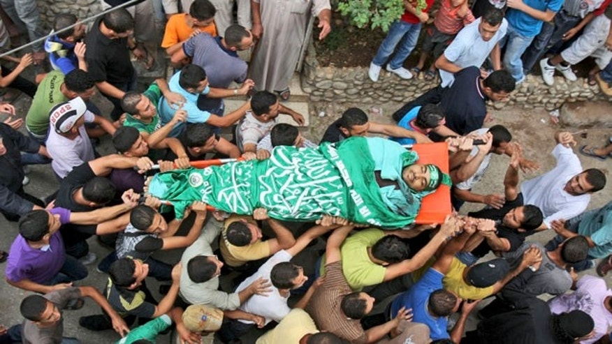 Sept. 17, 2010: Palestinian relatives and mourners carry the body of Hamas member Iyad Abu Shilbaya during his funeral in the Nur Shams refugee camp near the West Bank city of Tulkarem.