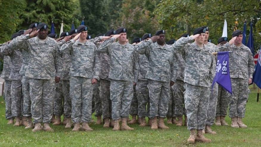 September 17: Soldiers of the US army salute at Daenner barracks in Kaiserslautern, Germany. The U.S. military says it has activated a new civil affairs brigade in Germany, the first of its type to be based in Europe. (AP)