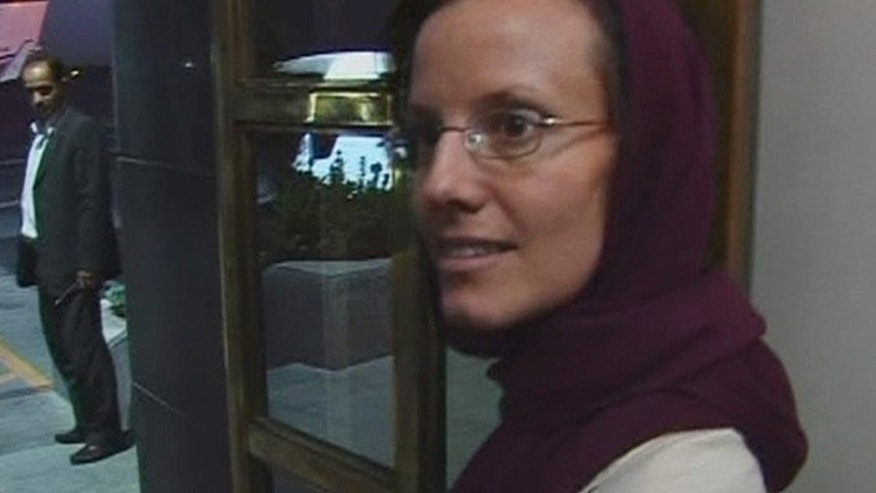 Sept. 14: American hiker Sarah Shourd leaves the airport in Tehran. (AP Photo)