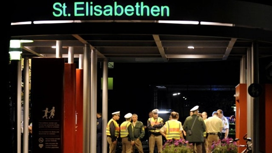 September 19: Police officers guard the entrance of the St. Elisabethen hospital in Loerrach, southern Germany. (AP)
