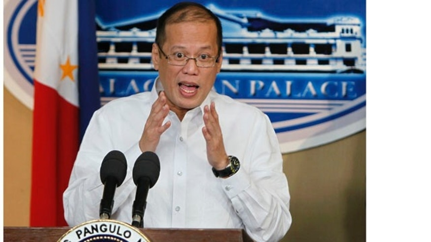 Sept. 20, 2010: Philippine President Benigno Aquino III gestures during a hastily-called news conference at the Presidential Palace in Manila, Philippines where he expresses hope that a government report that seeks to punish officials blamed for last month's bungled hostage rescue that killed eight Hong Kong tourists will pacify China and repair strained ties.