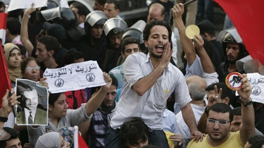 September 21: Egyptian activists shout anti - succession slogans during a protest in Cairo, Egypt. (AP)