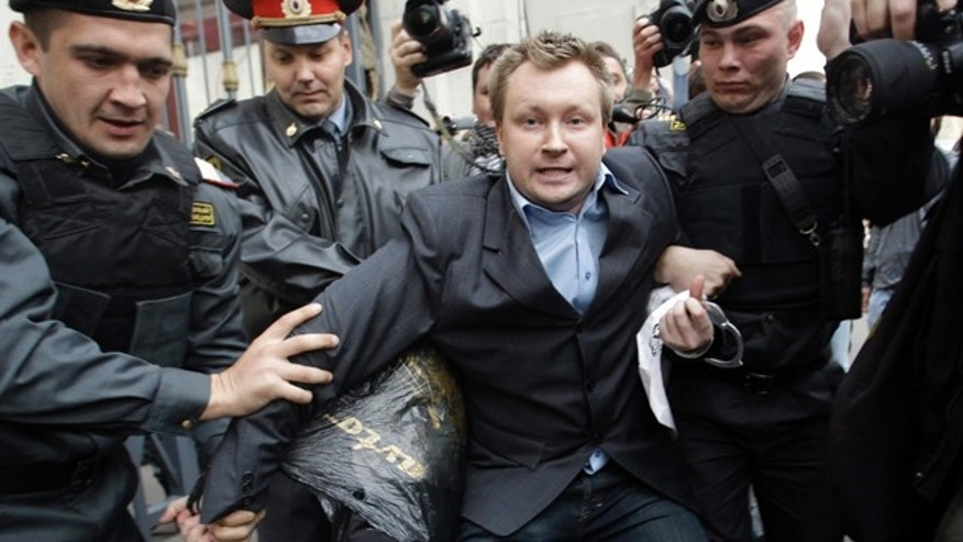 "September 21: Police officers detain Russian gay rights activist Nikolai Alexeyev during a rally near city hall in Moscow.  Mayor Yuri Luzhkov has called homosexuals ""satanic"" and routinely thwarted their attempts to hold a gay pride in Moscow. (AP)"