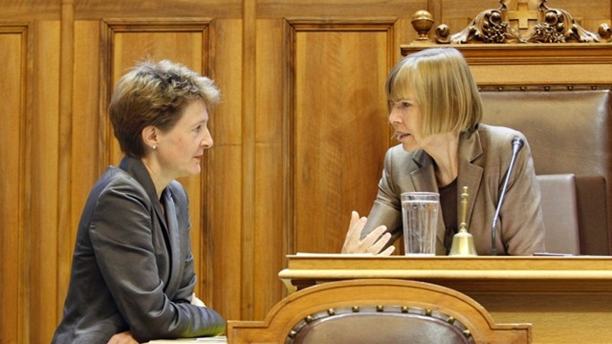 September 21: Swiss Social Democrat lawmaker Simonetta Sommaruga, talks to Erika Forster from the Free Democratic Party, during a session of the upper chamber of the Swiss parliament, in Bern, Switzerland. (AP)