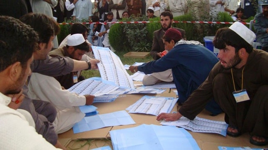 Sept. 20: Election workers count votes at the regional counting center in Khost, Afghanistan.