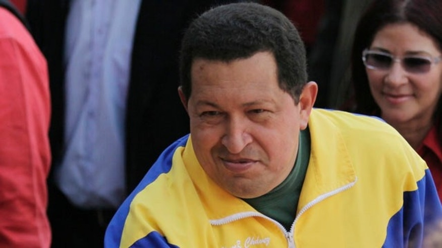 Sept. 26: Venezuela's President Hugo Chavez greets supporters upon his arrival to a polling station during congressional elections in Caracas, Venezuela.