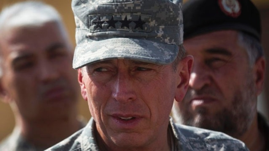 Sept. 27, 2010: Top American commander in Afghanistan Gen. David Petraeus tours the grounds of the U.S. run Parwan detention facility near Bagram north of Kabul, Afghanistan (AP).