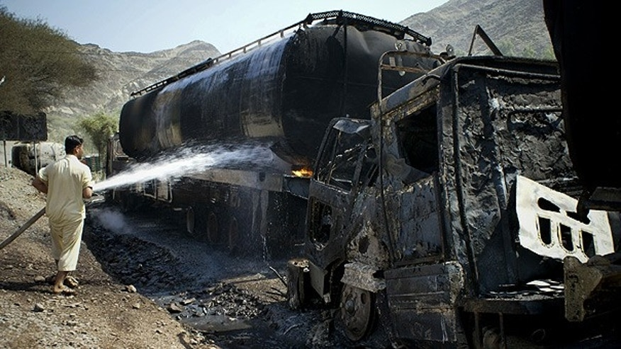 Sept. 24: A fire is extinguished after militants attacked oil tankers for NATO forces, in Khyber near Peshawar, Pakistan.